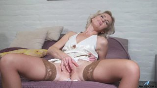 Sexy mature babe in stockings masturbates and suck a dick image