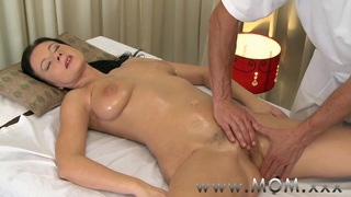 Stunning bodybuilder mom massage Mp4 videos - Mom brunette has the massage of her life image