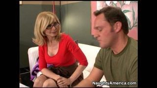 Slutty movie producer Nina Hartley puts every guy for cock audition image
