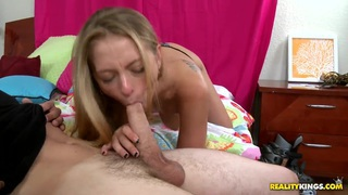 Eddiie Cox is lying on the bed and pleasuring hot deepthroat blowjob from sexy hot boobed chick Natasha Blaze. image