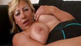 A hot big tit blonde granny masturbates before black stud drills her wet vagina image