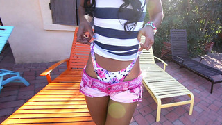 Ebony babe Misty Stone stripteasing near the pool image
