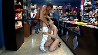 Marta La Croft deepthroating big dick in the sex shop image