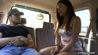 Lovely Japanese chick Ai Koda gives a blowjob in the_car in broad daylight image
