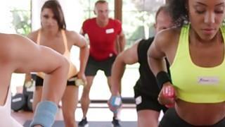 Ebony lesbian babe rubs brunette babe in gym image