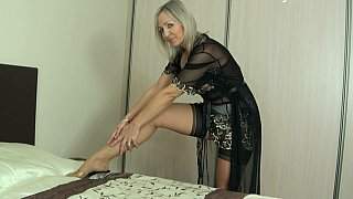 Mature wearing a garter belt_and sexy lingerie image
