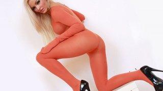 Image: Leggy blonde babe full body nylon tights suit
