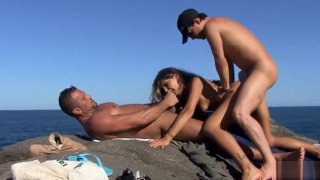Vayana getting fucked by_the shore in a threesome image