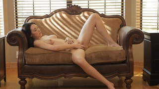 Buxom brunette Hanna Lay fondles her tits and pinches her puffy nipples on her way to satisfying... image