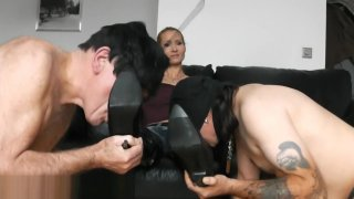 TWO SLAVES SUCK MISTRESS BOOTS image