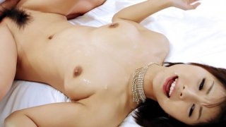 Azumi in black lingerie takes on two horny cocks and gobbles them both image