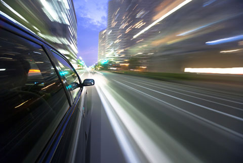 car in motion shutterstock image 231014191
