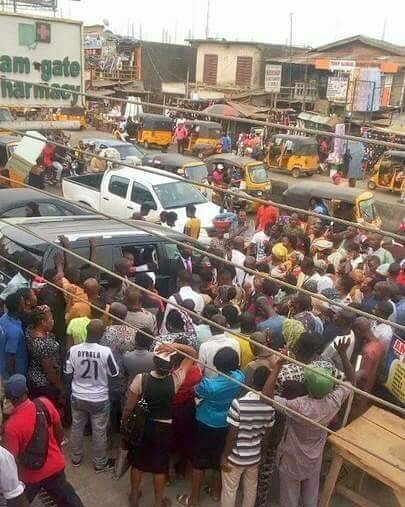 Bishop Oyedepo Spotted Preaching To People Near Devil's Shrine At Sango Otta