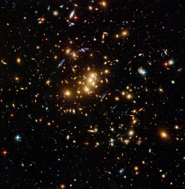 Hubble finds dark matter ring in galaxy cluster ESAHubble