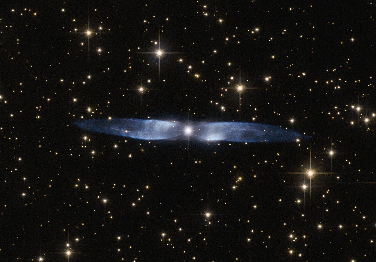In this cosmic snapshot, the spectacularly symmetrical wings of Hen 2-437 show up in a magnificent icy blue hue. Hen 2-437 is a planetary nebula, one of around 3000 such objects known to reside within the Milky Way.