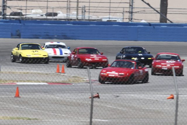 The traffic and hustle into the hard left-right complex leading onto the infield road course at Auto Club Speedway.
