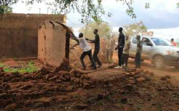 Locals in the bush after eviction for dam's expansion