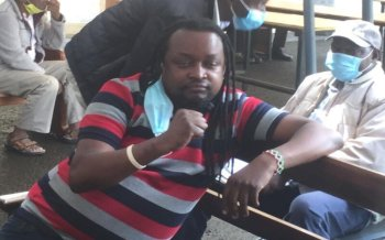 What 'Uhuru loans poster' suspect was charged with