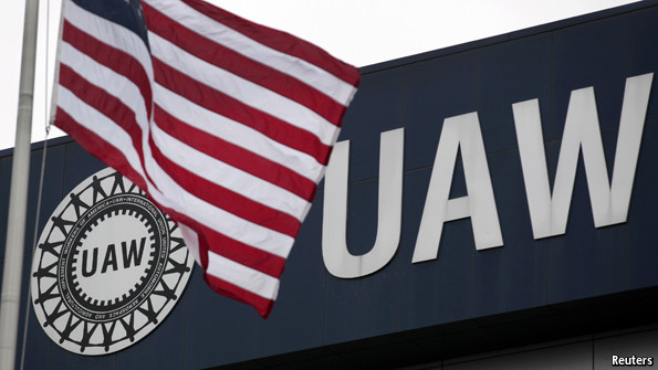 U.S. flag flies at a United Auto Workers  union hall (UAW).  Reuters photo, via The Economist