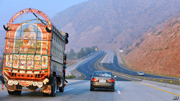 Behind a truck - Courtesy TheEconomist.com