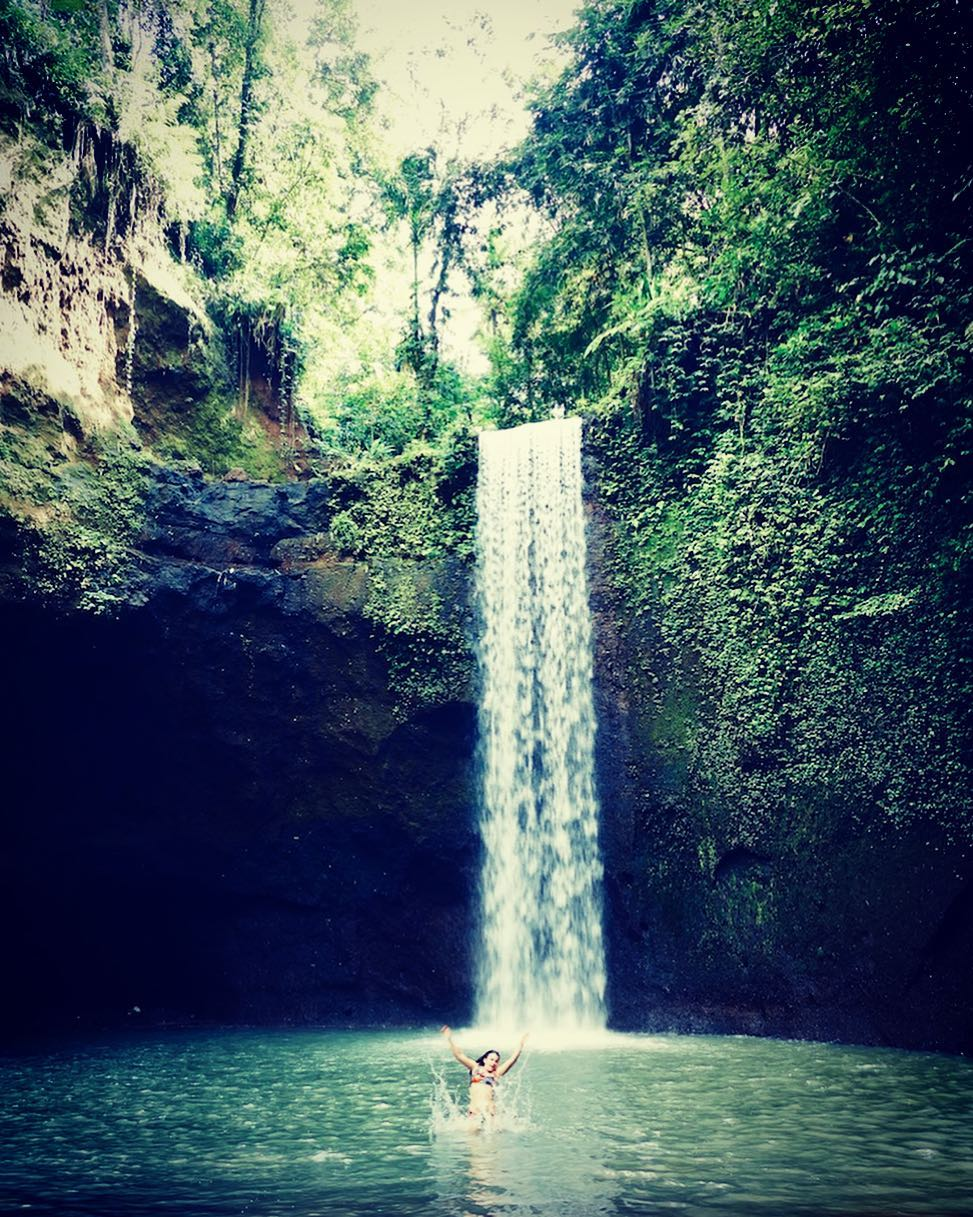 The Tibumana Waterfall Bali with a height of 20 meters has a large area with cliff walls overgrown with moss and green plants.  via @bookdevoyage