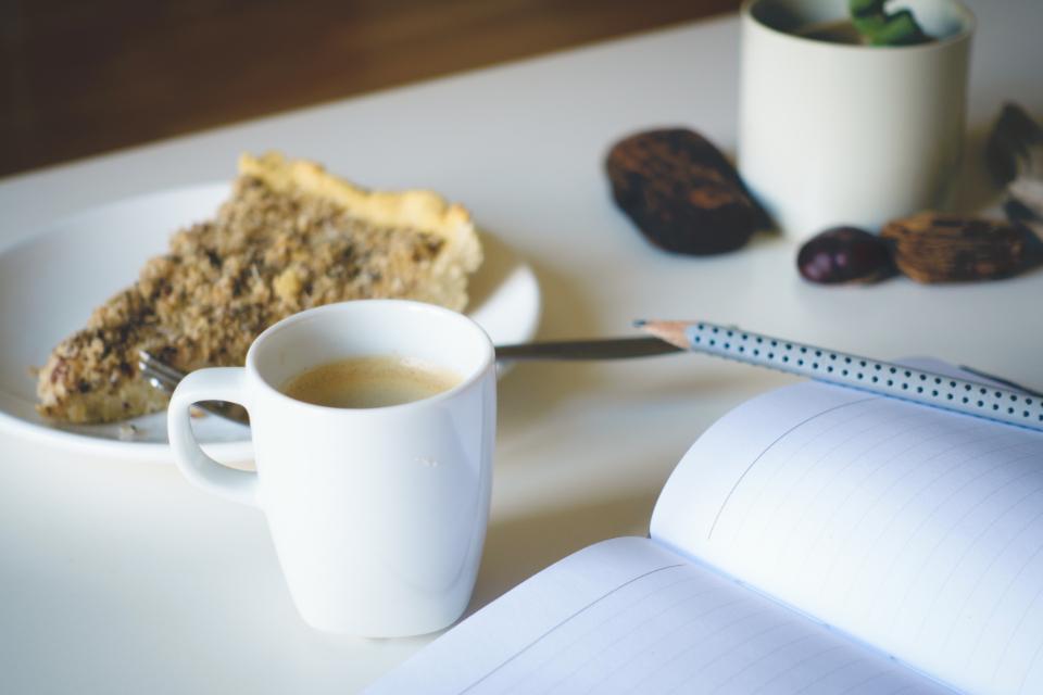 notepad notebook pencil writing work coffee cup mug cake dessert breakfast food table