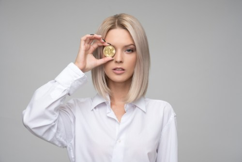 How to Make Money Blogging bitcoin finance cryptocurrency blond businesswoman woman female commerce shop dollar money