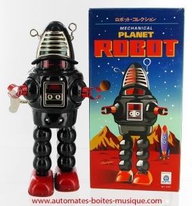 jouet mecanique de collection en metal robot mecanique en metal tole et fer blanc reference de ce robot en metal 601470