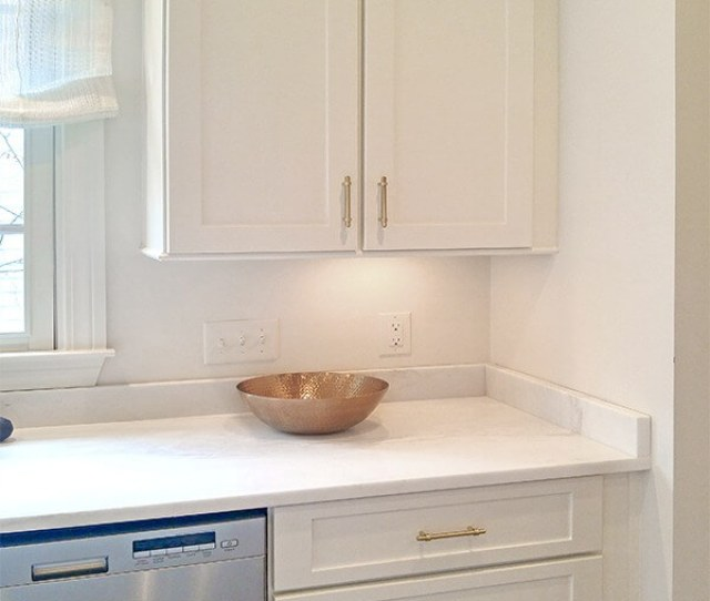Satin Brass Pulls Mix Well With Stainless Steel Appliances
