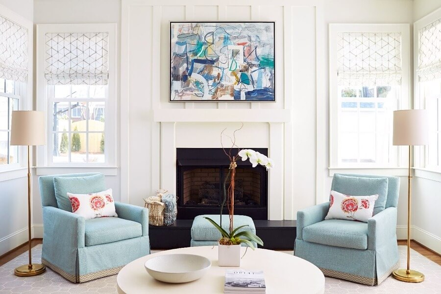 Two Swivel Chairs In Front Of Fireplace
