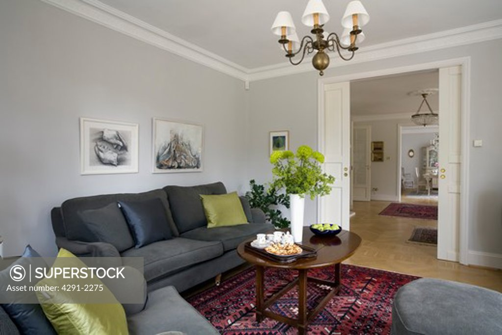 Lime Green Cushions On Charcoal Grey Sofas In Pale Grey Living Room With Open Sliding Double Doors Stock Photo 4291 2275 Superstock