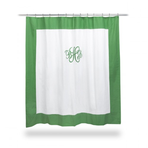 white shower curtain with green trim