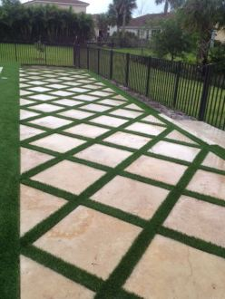 Synthetic Turf International SoftLawn Lawn and Landscape Artificial Grass with Pavers