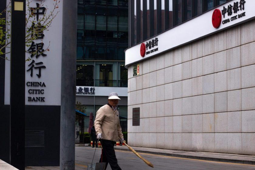 A worker sweeps the street near China Citic Bank in Beijing April 9, 2019. (Image credit: TechNode/Cassidy McDonald)