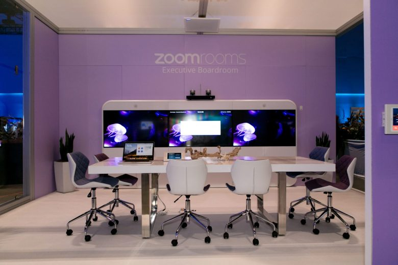 In this image provided by Zoom, there is an empty conference room with the company's video conferencing tools on display. (Image credit: Zoom)