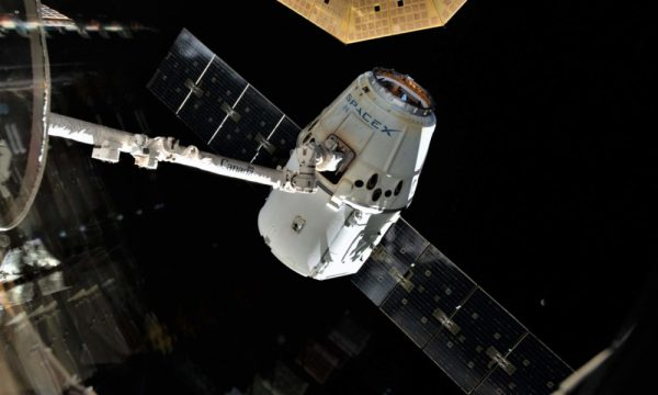 SpaceXs Cargo Dragon spacecraft nears space station with