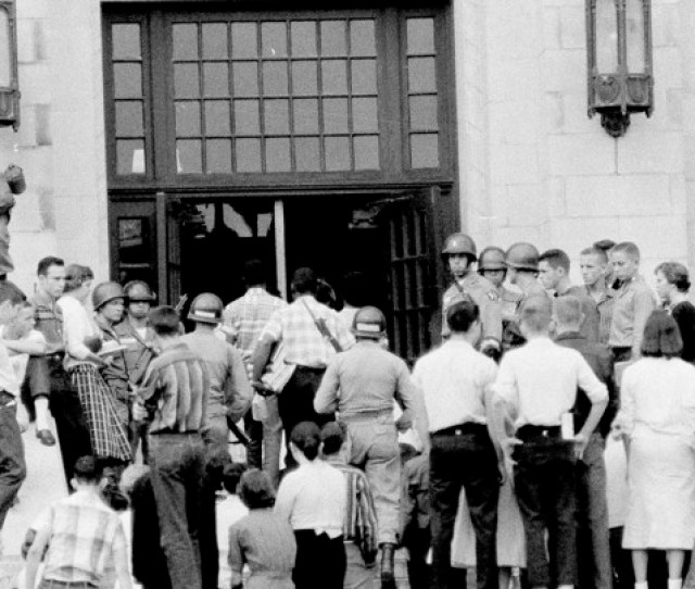 Black Students Are Escorted Through The Front Door Of Central High School In Little Rock