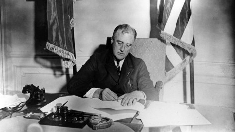 Franklin D. Roosevelt signs the Emergency Banking Act