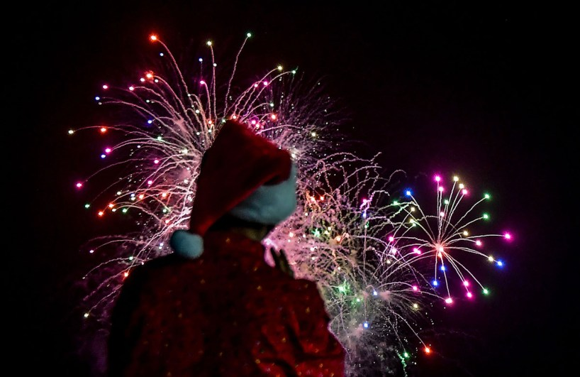 A man watches fireworks during the Christmas parade in Panama City on December 16, 2018