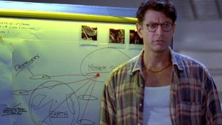 "Scene from Independence Day where Jeff Goldblum realizes he can ""give the aliens a cold"". An egregious example of the ""plot solution in a random sentence tropes."""