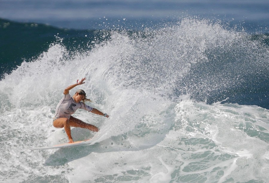 A surfer rides a wave during a surfing contest.