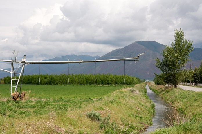 Irrigation ditch and sprinkler, Silver Creek, Idaho.