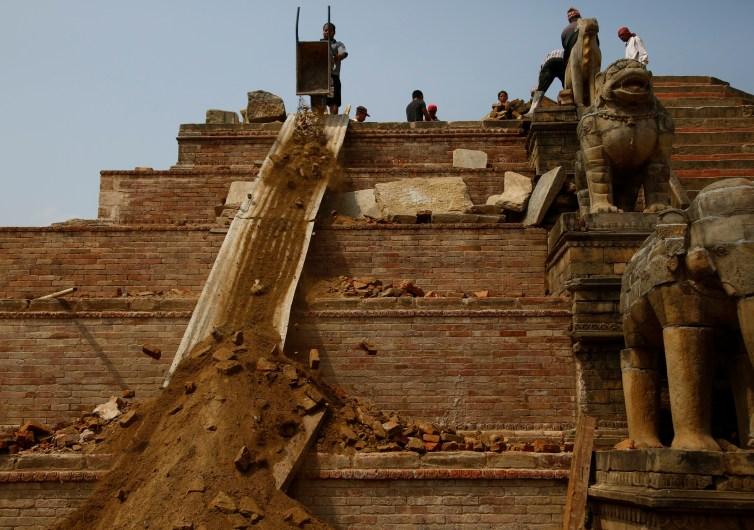 Workers rebuild a temple damaged during the 2015 earthquake, in Bhaktapur. Credit: Reuters/Navesh Chitrakar