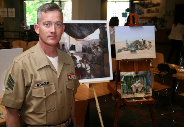 Kristopher Battles with some of his work | © Cpl. Alicia R. Giron/WikimediaCommons