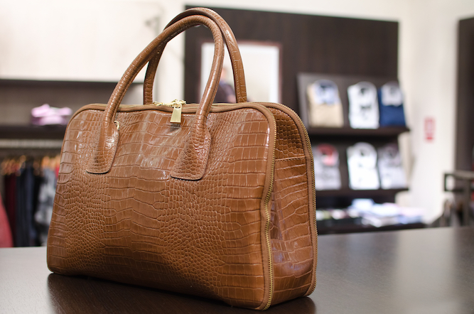 Woman's handbag basically a dustbin with leather handles