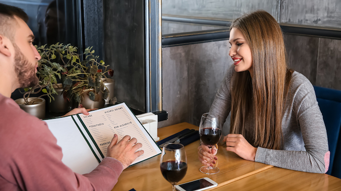 Man seductively orders second cheapest bottle of wine at restaurant