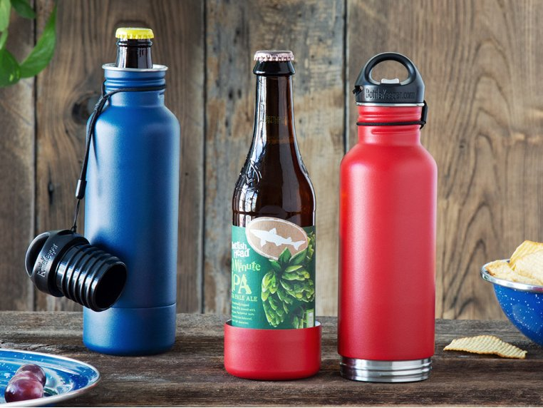 BottleKeeper insulated beer bottle holders sit on a table with a bottle of Dogfish Head IPA