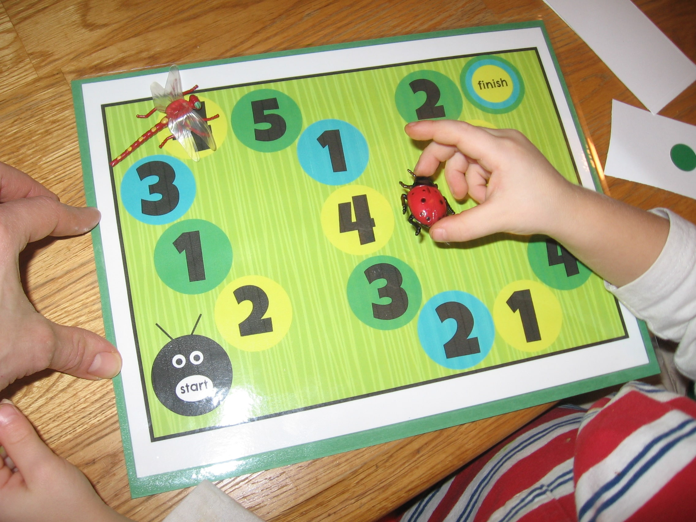 Buggy Board Game   a first board game for preschoolers   The     child placing toy bug on counting mat