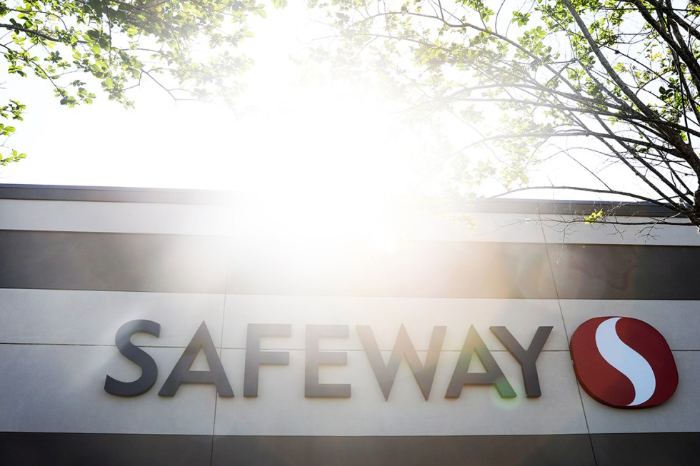 The sign for Safeway on their building is photographed as the sun shines.