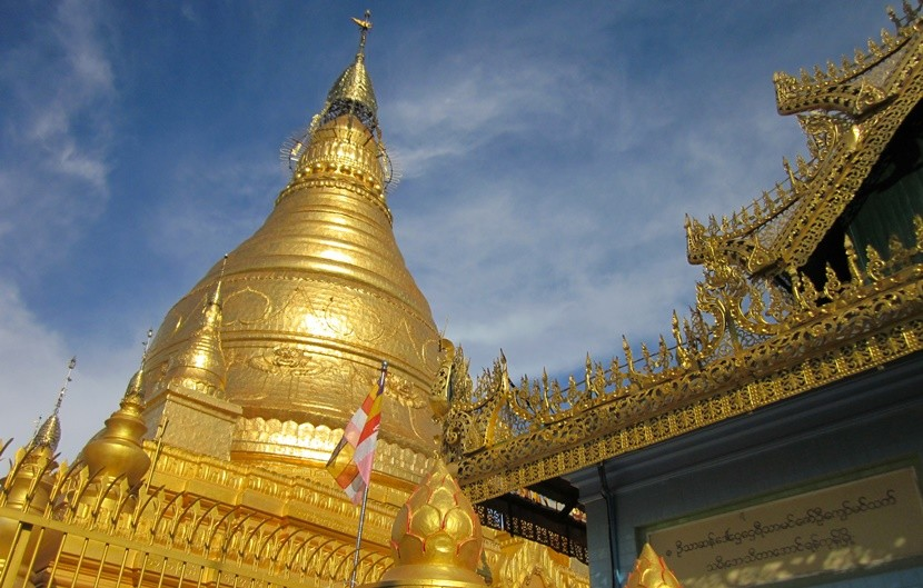 Golden temples shine in the sun in Myanmar.